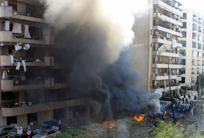 Flames rise from the site of a blast in Bir Hassan neighbourhood in southern Beirut on Nov. 19, 2013.