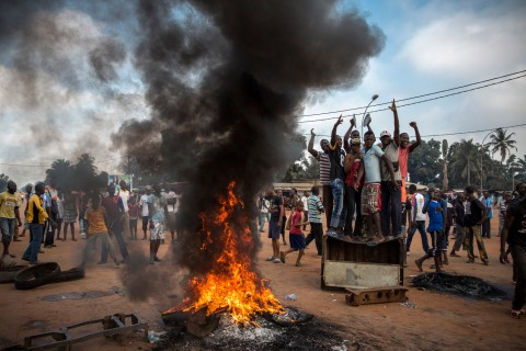 People demonstrate violently in the street in Bangui, demanding that President Djotodia steps down following the murder of a magistrate shot dead the night before. 30 minutes later, the Seleka arrived and fired into the crowd, killing two men and wounded one.