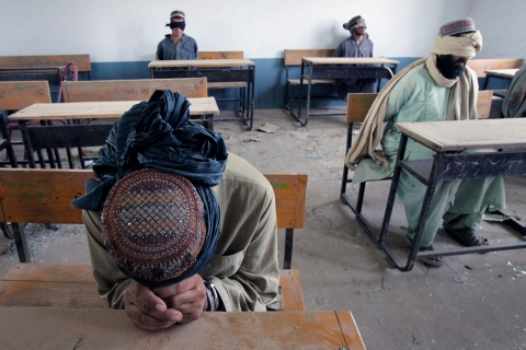 A group of men detained for suspected Taliban activities are held for questioning at a schoolhouse in the village of Kuhak