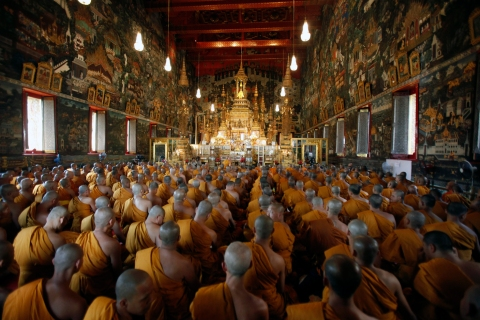 Buddhist monks pray during a religious ceremony held to mark King Adulyadej's 84th birthday anniversary at the Wat Phra Kaew Temple of the Emerald Buddha in Bangkok