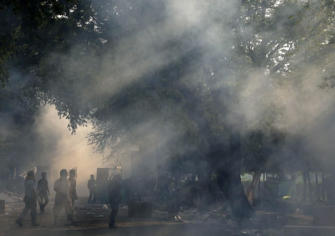 Thai police repel protesters with tear gas, rubber bullets
