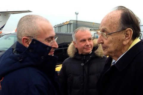 From right: Hans-Dietrich Genscher of the liberal Free Democratic Party (FDP) welcomes Russian former oil tycoon Mikhail Khodorkovsky at Berlin's Schonefeld airport, on Dec. 20, 2013.