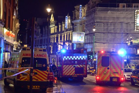 Emergency services attend the scene at the Apollo Theatre in Shaftesbury Avenue, central London, Dec. 19, 2013.