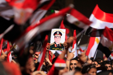 Anti-Mursi protestors hold a poster of General Abdel Fattah al-Sisi in Tahrir Square in Cairo, on July 3, 2013.