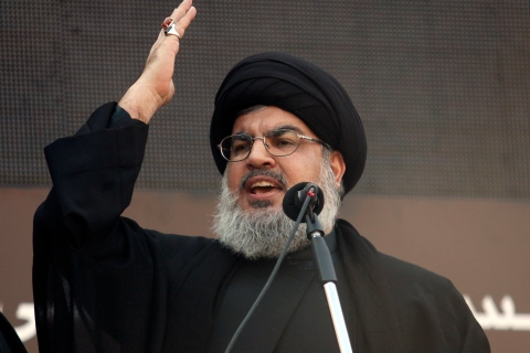 Lebanon's Hezbollah leader Sayyed Hassan Nasrallah addresses his supporters during a religious procession to mark Ashura in Beirut's suburbs, on Nov. 14, 2013.