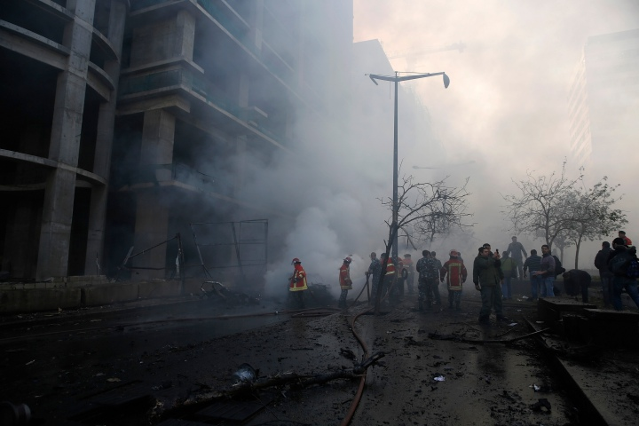 Fire fighting and army personnel inspect the site of an explosion in Beirut's downtown area