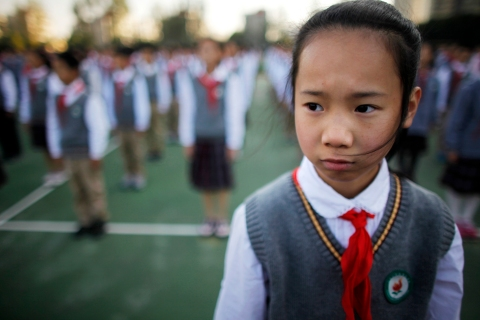 A Young Pioneer attends the weekly flag-raising ceremony at the East Experimental School in Shanghai