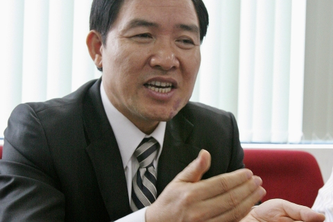 Former Vinalines Chairman Duong Chi Dung speaks during an interview at his office in Hanoi
