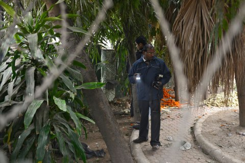 Forensic officials examine a spot where a Danish woman alleged she was robbed and gang-raped, in New Delhi