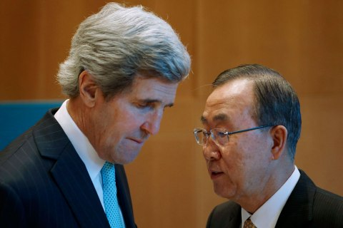 U.S. Secretary of State Kerry listens to U.N. Secretary-General Ban Ki-moon prior to peace talks in Montreux
