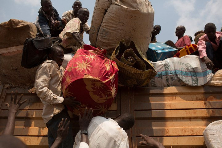People being repatriated to Chad load their belongings on a truck in Bangui