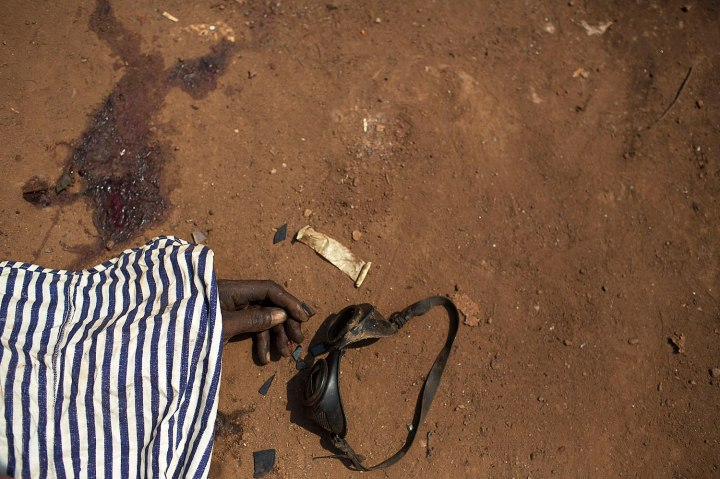 The dead body of a man killed during one of the latest incidents of sectarian violence is pictured on the ground in the district of Combattant near the airport of the capital Bangui