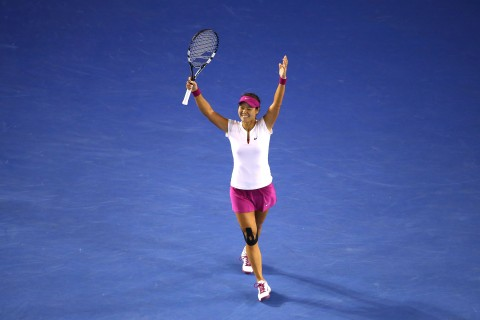 Li Na of China celebrates winning the 2014 Australian Open at Melbourne Park on January 25, 2014 in Melbourne.