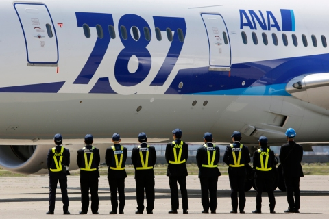 Employees of All Nippon Airways queue in front of the company's Boeing 787 Dreamliner plane after it's test flight at Haneda airport in Tokyo