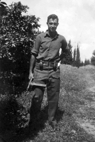 Ariel Sharon holds a Sten gun as a young commander in the Alexandroni Brigade of the fledging Israeli army during the War of Independence in Israel, in 1948.