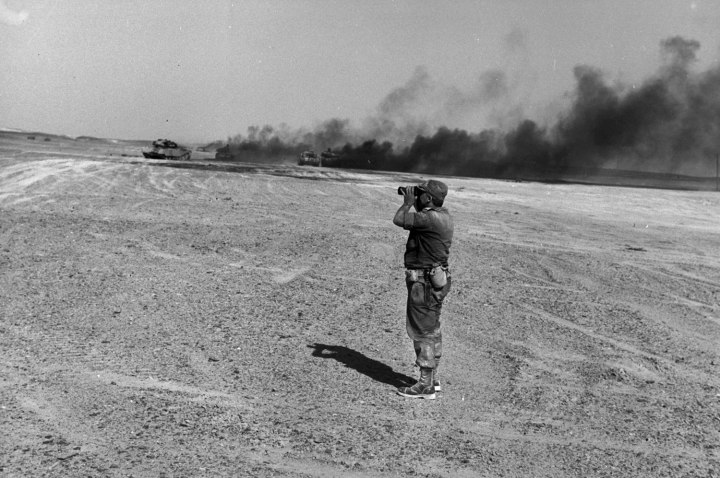 Brigadier General Ariel Sharon watches an aerial drop in the Sinai Desert during the Six Day War, on June 8, 1967.