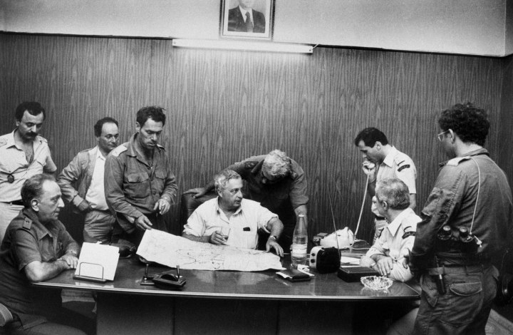 In the fall of 1982, Defense Minister Ariel Sharon was at the head of the forces entering Lebanon, seen here south of Beirut with General Zeev Almog leaning over his shoulder.