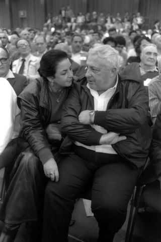 From right: Ariel Sharon and his wife Lily sit in the audience during a convention of the right-wing Herut party, on March, 10, 1986 in Tel Aviv.