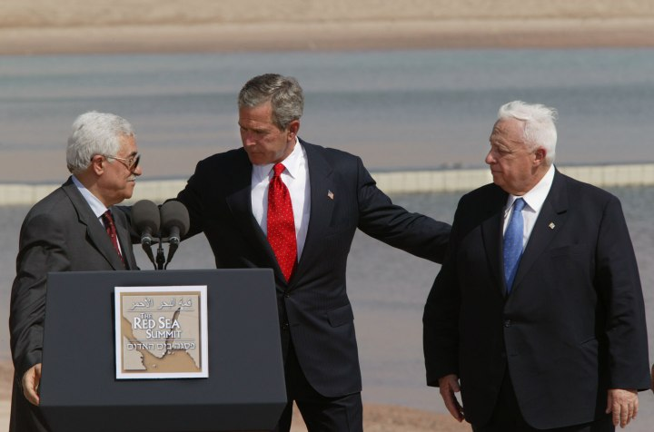 U.S. President George Bush (center) makes statements with Israel Prime Minister Ariel Sharon (right) and Palestinian Prime Minister Mahmoud Abbas (left) at the conclusion of The Red Sea Summit in Jordan, on June 04, 2003.
