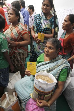 Subsidized food grains are distributed to eligible families in New Delhi on Sept. 1, 2013