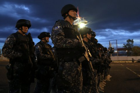 Members of the Federal Police arrive Morelia city, Michoacan state, Mexico on Jan. 13, 2014.