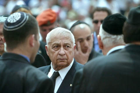 In this Monday, April 26, 2004 file photo, Marking Israeli Memorial Day, Israeli Prime Minster Ariel Sharon greets family members of terror victims, after a memorial ceremony for Israeli civilians who have been killed since Israel's founding 56 years ago, at Mt. Herzl Cemetery, in Jerusalem.