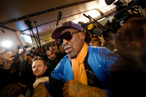 Dennis Rodman is surrounded by journalists upon his arrival from North Korea's Pyongyang at Beijing Capital International Airport