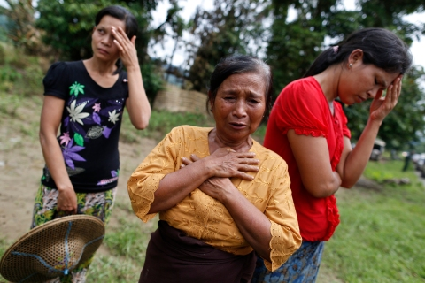 Muslim women react to the loss of their homes which were burnt down in recent violence in Pauktaw village, outside of Thandwe in the Rakhine state