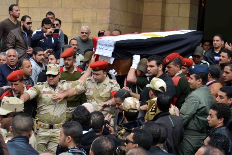 Relatives and army soldiers carry the coffin of Egyptian pilot Ahmed Abul Atta, who was killed in an army helicopter crash in Sinai Peninsula a day earlier, during the funeral procession in Port Said, Egypt, on Jan. 26, 2014.