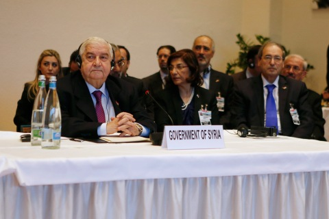 From left: Syria's Foreign Minister Walid al-Moualem leads his delegation during a plenary session in Montreux Jan. 22, 2014.