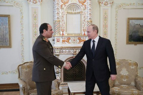 From right: Russia's President Vladimir Putin shakes hands with Egyptian Defense Minister Abdel Fattah al-Sisi during a meeting at the Novo-Ogaryovo state residence outside Moscow, on Feb. 13, 2014.