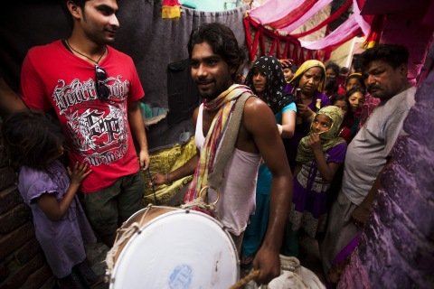 An Indian drummer leads a group of women during a wedding procession in Kathputli Colony in New Delhi, June 2013.