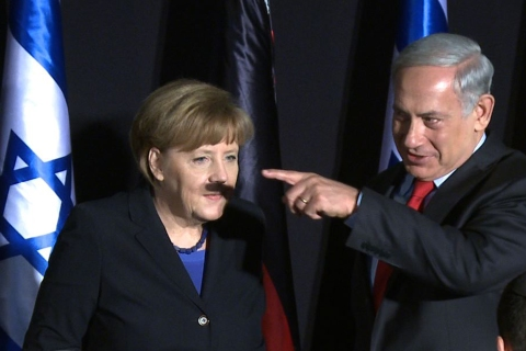 In this video-grab, German Chancellor Angela Merkel (L) and Israeli Prime Minister Benjamin Netanyahu gesture during a joint press conference after their cabinets held a meeting at the King David hotel in Jerusalem on February 25, 2014.