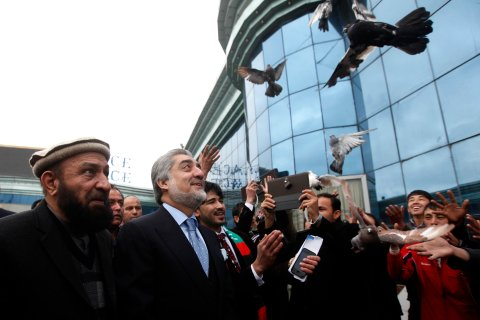 Supporters of Afghan presidential candidate Abdullah Abdullah release pigeons during the first day of the presidential election campaign in Kabul