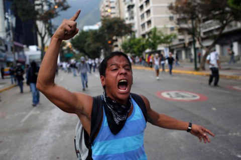 A demonstrator shouts slogans against Bolivarian National Guards during clashes in Caracas, March 2, 2014.