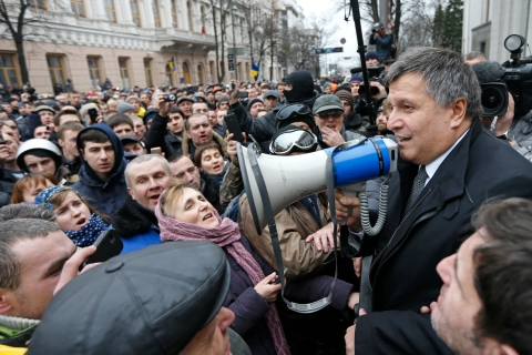 Newly elected Ukrainian interior minister Arsen Avakov holds a loud-speaker as he addresses anti-government protesters outside the Ukrainian parliament building in Kiev