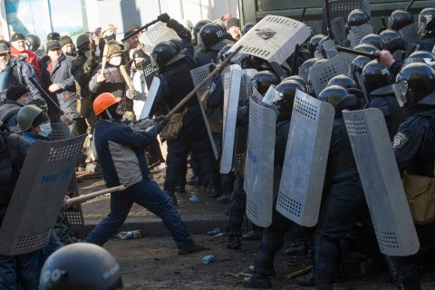 Interior Ministry members clash with anti-government protesters during a rally in Kiev, on Feb. 18, 2014.