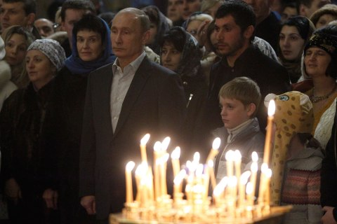 Russia's President Putin attends the Orthodox Christmas service at the Holy Face of Christ the Savior Church in the Russian southern city of Sochi