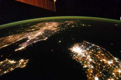 A NASA image released on February 24, 2014 shows a photo taken by the Expedition 38 crew aboard the International Space Station on January 30, 2014 of the night view of the Korean Peninsula.