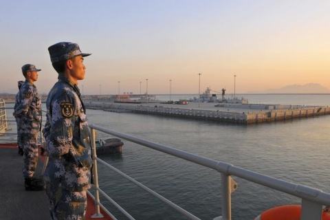 Chinese soldiers stand guard on Liaoning