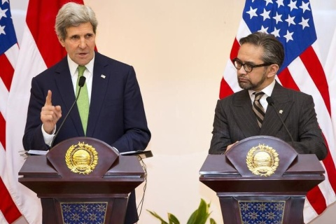 John Kerry speaks during news conference with Natalegaw