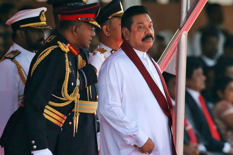 Sri Lanka's President Mahinda Rajapaksa, right, listens to Army Commander Lt. Gen. Daya Ratnayake during celebrations of Sri Lanka's 66th Independence Day northeast of Colombo, Sri Lanka, Feb. 4, 2014.