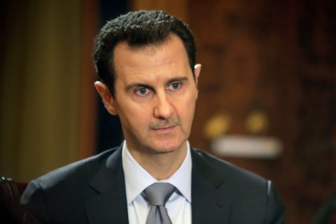Syrian President Bashar al-Assad during an interview with AFP in at the presidential palace in Damascus, in a photo released on Jan. 20, 2014.