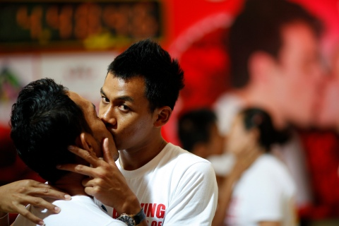 Men kiss among other couples participating in the Guinness World Record attempt in the longest continuous kiss in Pattaya