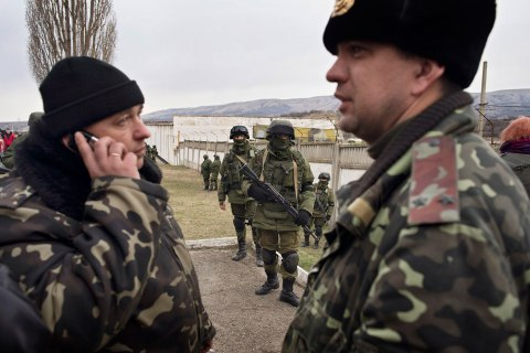 The Ukrainian commander, Col. Sergei Storozhenko, left, outside of his base in the Crimean village of Perevalnoye, on March 2, 2014.
